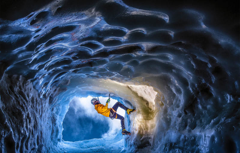 climbing-in-a-glacial-ice-cave-in-the-alps