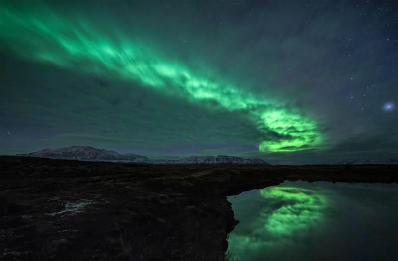 aurora-borealis-behind-clouds