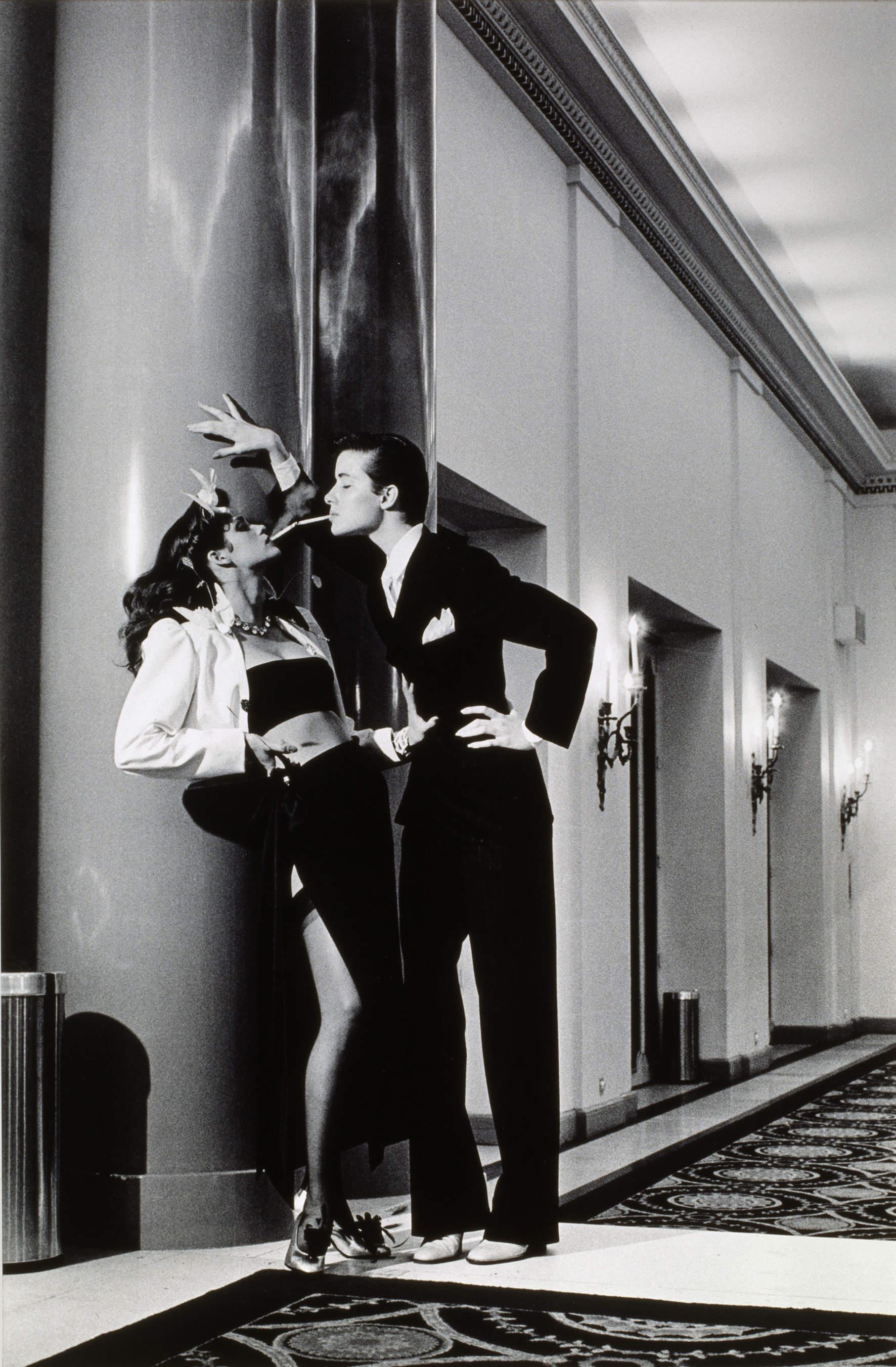 Vogue, Paris, Yves Saint Laurent Woman into Man, lighting a ciga